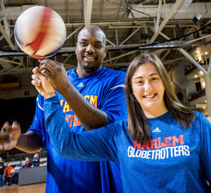 Stephanie Guzzo on the court with the Harlem Globetrotters