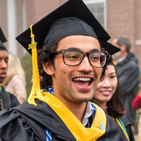 Student wearing cap and gown at commencement