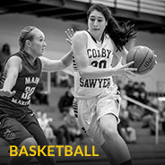Colby-Sawyer women's basketball player moving down court