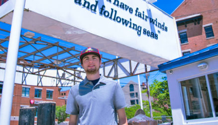 Sport management major Will Highland stands near the harbor in Portland, the location of his internship with the Sea Dogs.