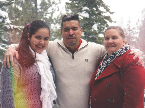 Paulina Olvera '19 with her parents, Eladio and Sarah