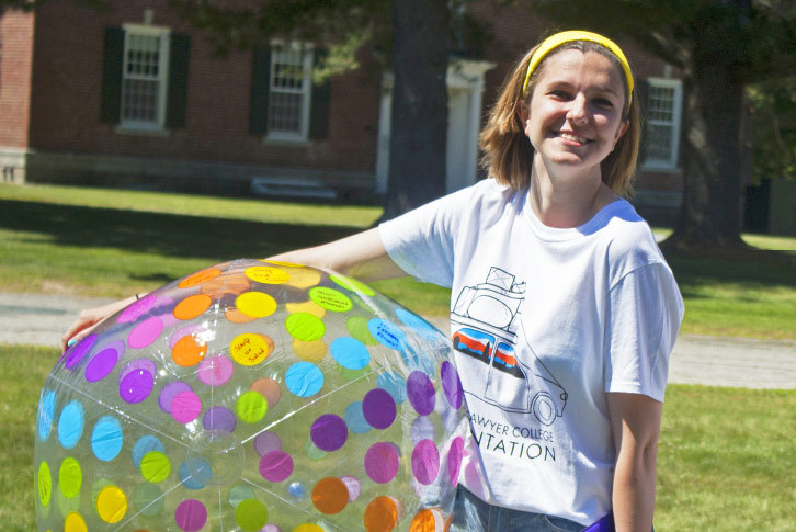 A Colby-Sawyer student holds a beach ball.