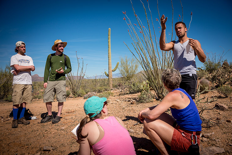 Colby-Sawyer students examin the desert landscpe during Desert Communities field studies class