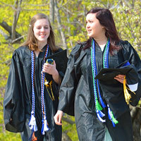 Graduates walking together at commencement