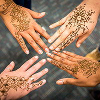 Students with henna tattoos at International Festival