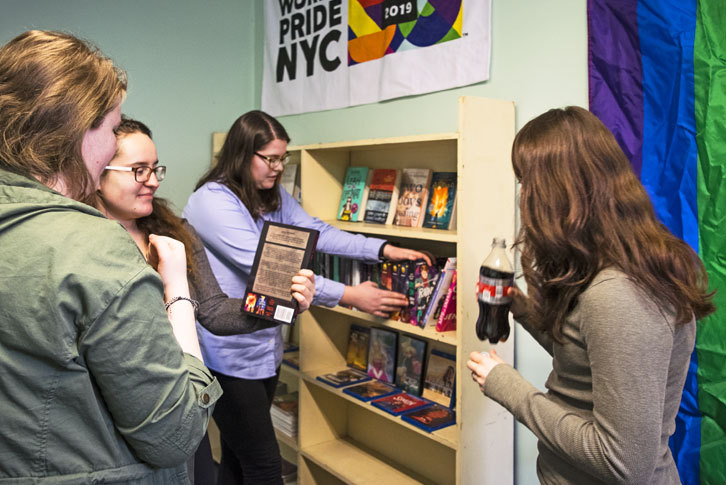 Students selecting books from the resource library.