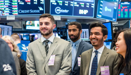 Business administration students taking a tour of the New York Stock Exchange.