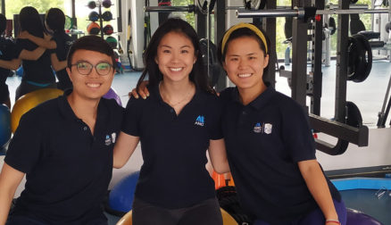 Three interns standing together at a sports medicine day surgery center in China.