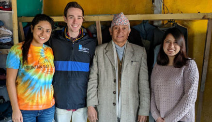 Colby-Sawyer students in a Nepal thrift store with the store owner during its refurbishment.