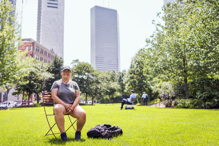 Colby-Sawyer student Nicole Sememaro '18 sits on a chair in Boston's Rose Kennedy Greenway.