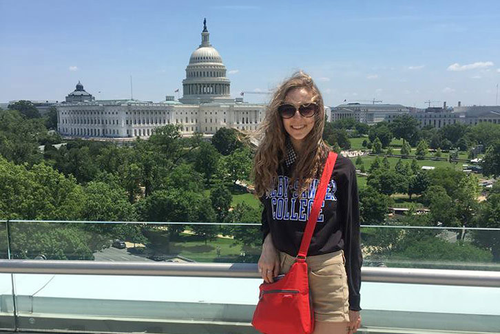 Ayla Cordell stands in front of the D.C. skyline.