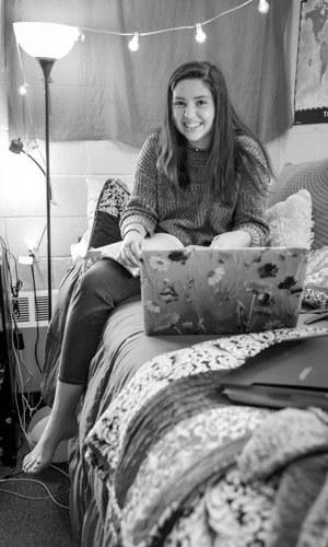 Student in her dorm room studying